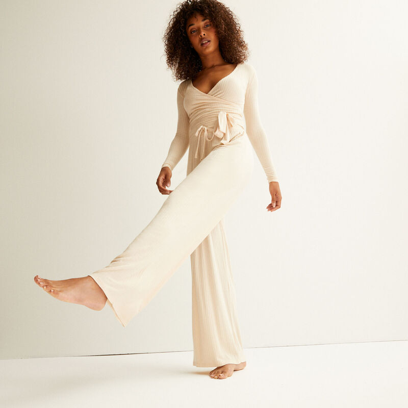 flared knit trousers - cream;