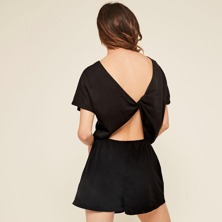 Crossistoniz black jumpsuit;