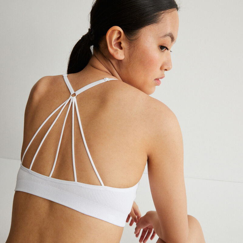 Openwork cleavage bra with crossed back - white;