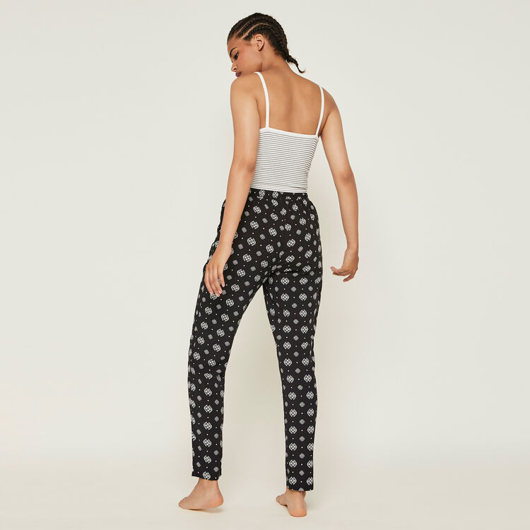 Arabeskiz arabesque pattern trousers;