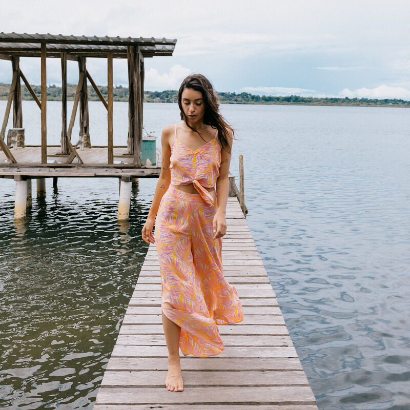 Wide open trousers with palm motifs - orange;
